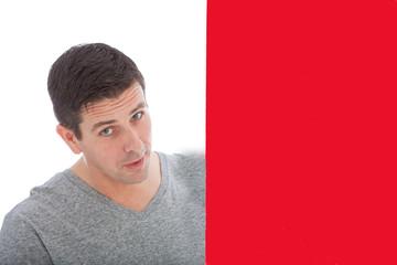 Gorgeous Man Peeking Behind Red Wall