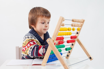 Cute boy, learning to count and math