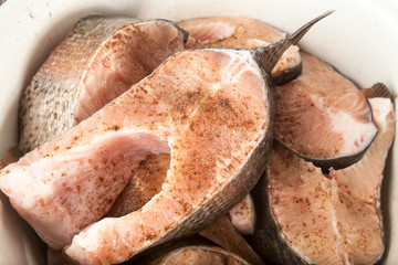 Chunks of raw trout sprinkled with pepper and salt