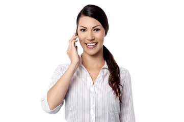 Cheerful lady talking on cell phone