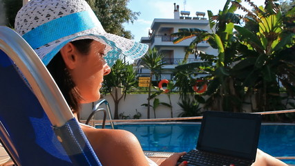 Working on laptop at the pool