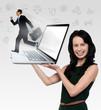 Smiling woman holding laptop