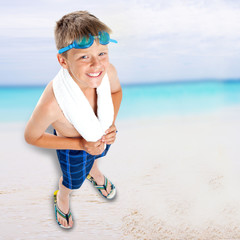 Smiling boy standing on beach background