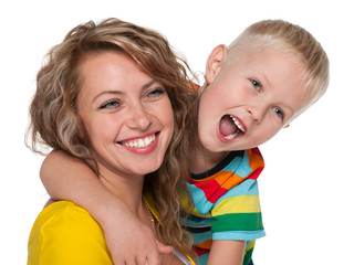 Laughing little boy and his mother