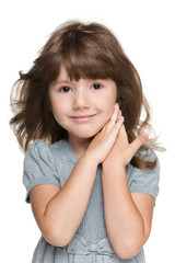 Shy little girl against the white