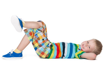 Little blond boy resting on the floor