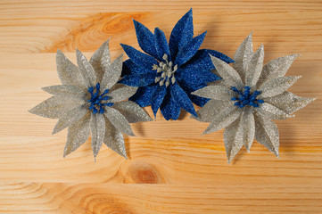Christmas decorations flowers on a wooden background