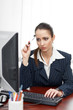 Young businesswoman thinking at desk