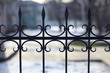 Leinwanddruck Bild - forged lattice fence gate