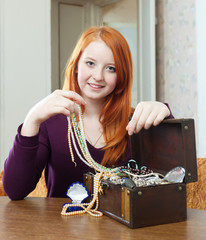 teen  chooses jewelry
