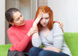 Mother gives solace to crying  daughter