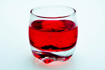 Cherry cocktail  in a glass isolated on a white background