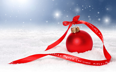 Holiday background with bauble, merry christmas ribbon in snow