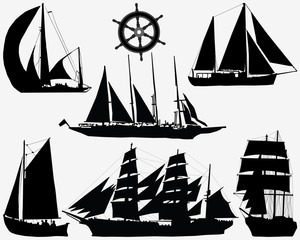 Black silhouettes of ships and rudder, vector illustration