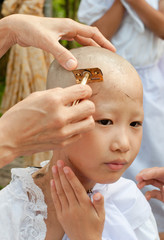girl be removed hair to become a nun during a Buddhist ordinatio