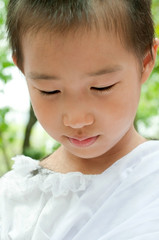 closed up child's face in the white cloth