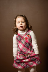 Portrait of beautiful little girl looking at the camera