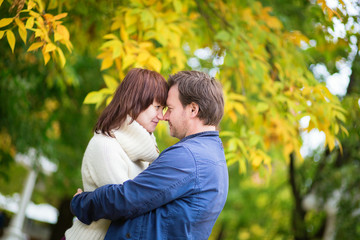 Happy loving couple outdoors on a fall day