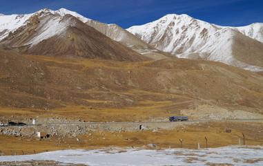 Truck and mountains at Khunjerab pass at china-pakistan border i