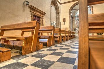 Row of pews in Santa Maria church in Alghero
