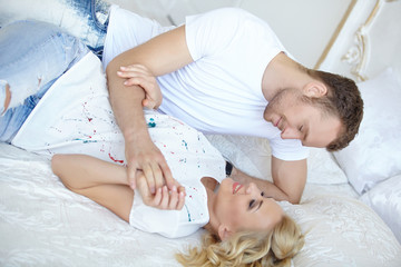 Couple in love sleeping in bed