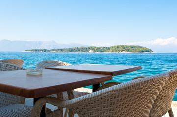 Local cafe in font of the Lazaretto Island. Corfu, Greece.