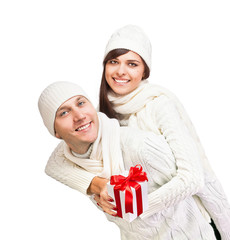 Young couple with Christmas gift