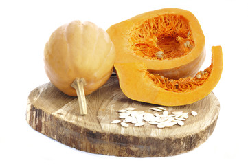 Pumpkins and Pumpkins seeds on wood and white background