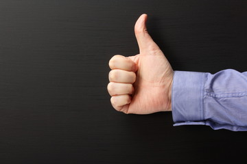 Thumbs Up sign in front of a blackboard