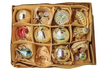 Box with vintage Christmas balls isolated on white
