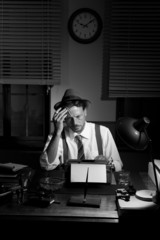 Reporter working late at night and smoking in his office