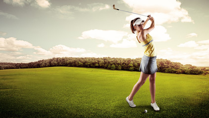 Active woman player hitting the ball on golf court