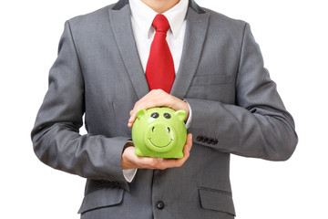 Business mna holding piggy bank