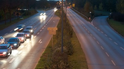 time lapse of car traffic on highway at night