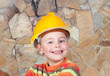 Young constructor with a stone wall of background