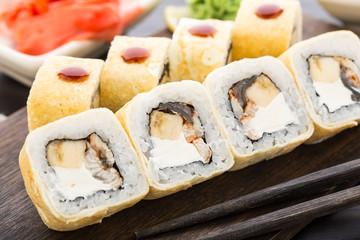 Sushi rolls with smoked eel and banana