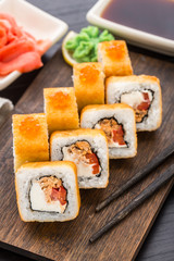 Fried sushi roll with salmon teriyaki