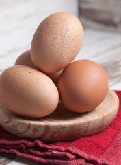 Eggs piled on a wooden plate