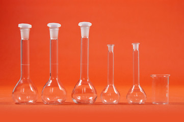 Chemistry science - flasks on orange background
