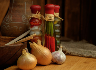 Onions and garlic on a wooden table.