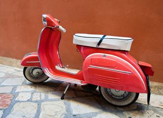 Vintage Vespa scooter on Kerkyra street on Corfu island. Greece.