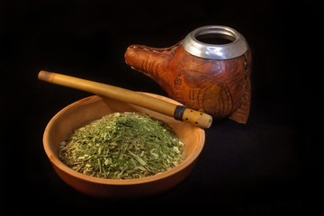 leather covered calabaza and cup of yerba mate