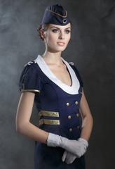 Charming Stewardess Dressed In Blue Uniform.