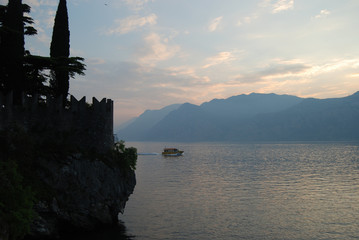 Garda lake with partial view of the Scaliger Castle, Malcesine