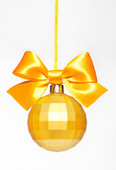 Christmas gold ball with bow isolated