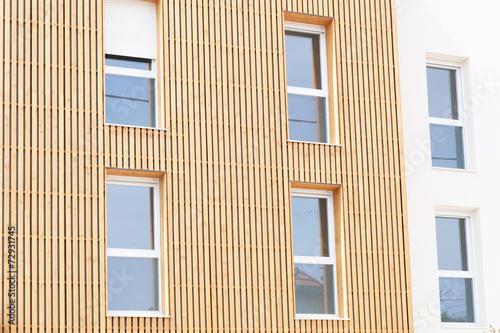 wooden facade of a house - 72931745