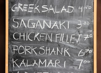 Blackboard menu of Greek cuisine