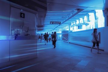 crowd silhouette of people inside modern railway hub building
