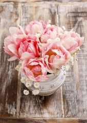 Romantic bouquet of pink tulips and gypsophilia paniculata