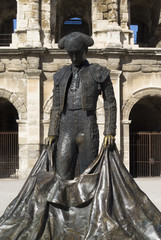 Statue of famous bullfighter in front of the arena in Nimes